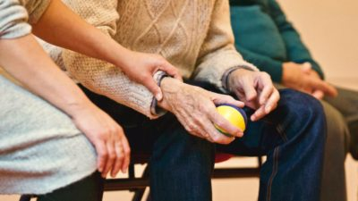 who is caring for the carers. Image of a carer with an older person.