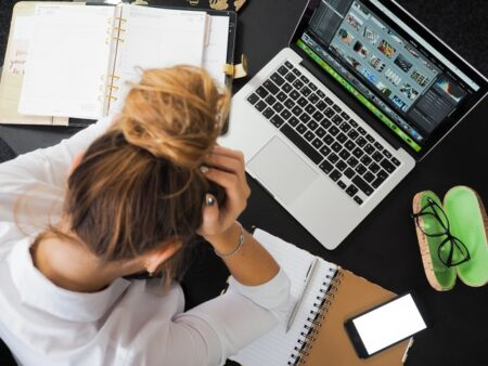Woman stressed and anxious at work